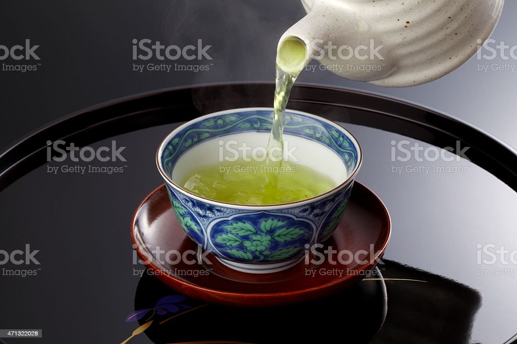 Japanese green tea in porcelain cup and tea pot. stock photo