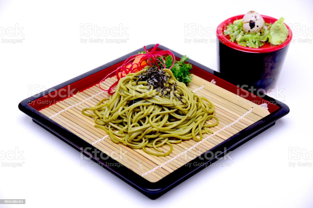 Japanese Greentea Soba Noodles with Dipping Sauce , Cha Soba isolated on White Background with Clipping Path stock photo