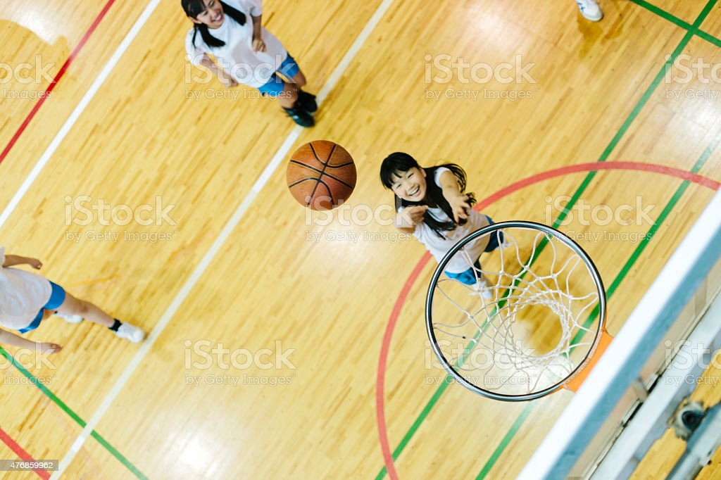 Japanese high school. A school gymnasium. Children play basketball stock photo
