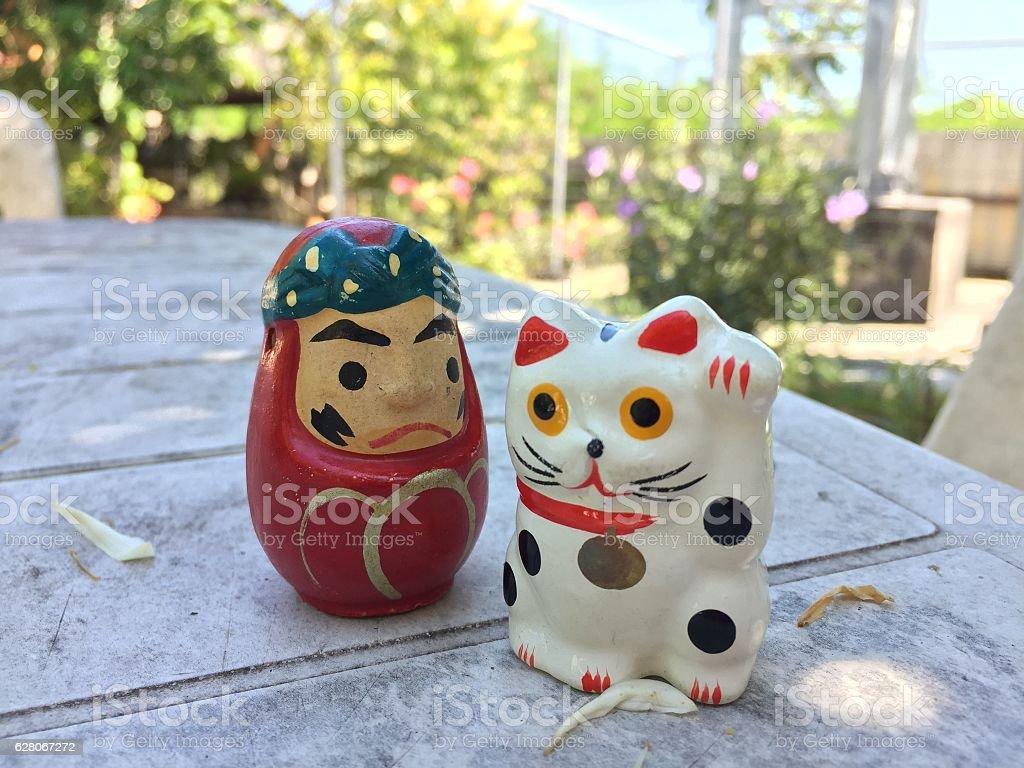 Japanese Lucky cat (Maneki-neko) and daruma doll stock photo