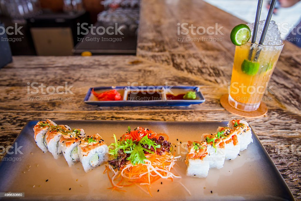 Japanese lunch set with maki sushi, salmon sashimi and salad stock photo