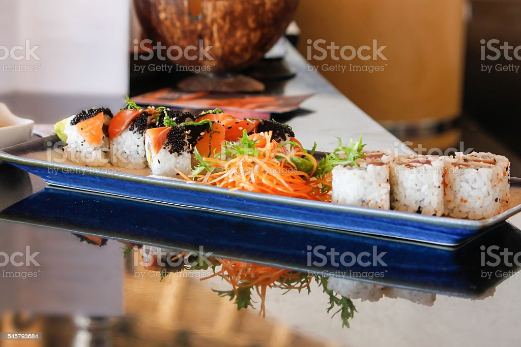 Japanese maki sushi roll and salad stock photo