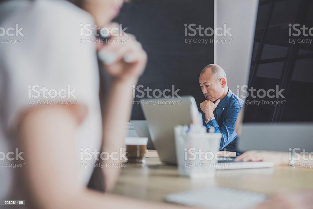 Japanese man at work in design studio stock photo