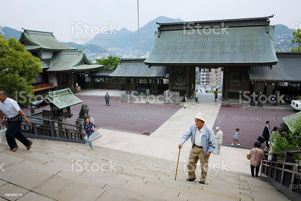 Japanese man climbing stairs to Shinto Shrine royalty-free stock photo