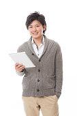 Japanese man holding a digital tablet