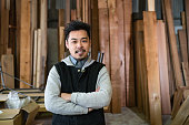Japanese man in his thirties in a small business environment