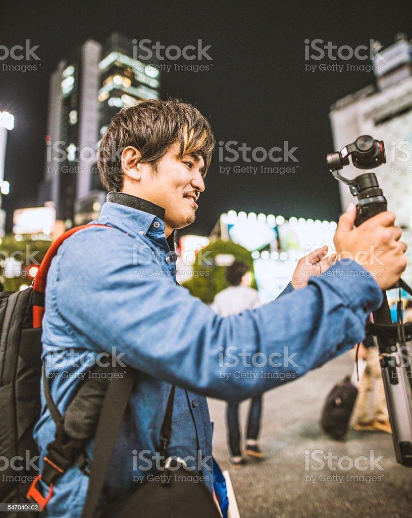 Japanese man walking on the street stock photo