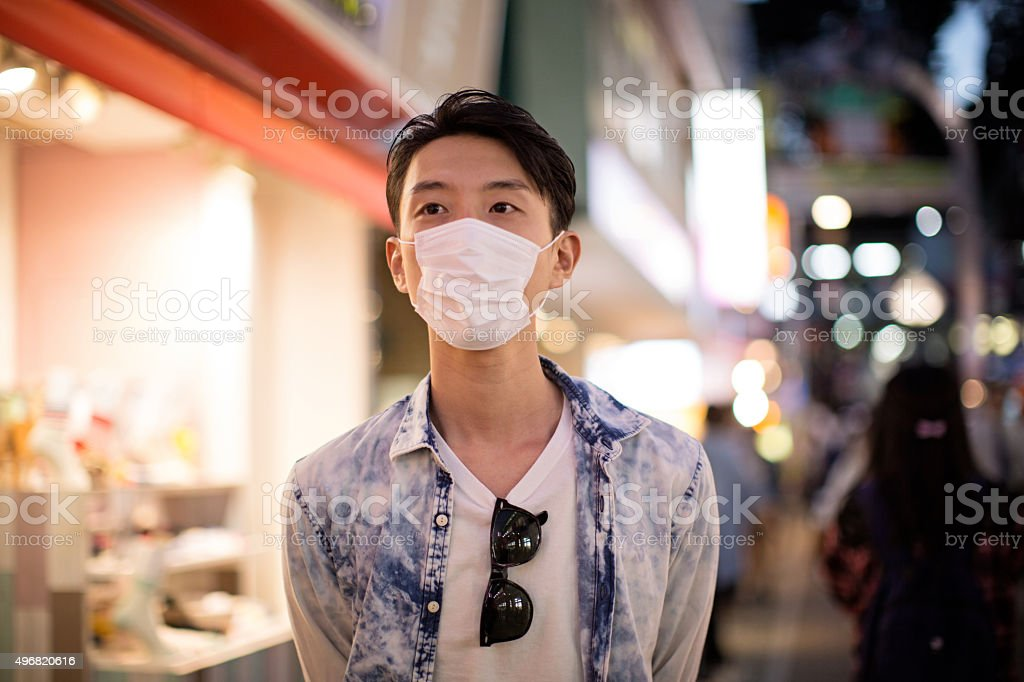 Japanese man wearing protective mask in Tokyo stock photo