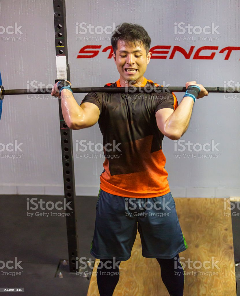 Japanese Man Weightlifting During a Cross Training Workout stock photo