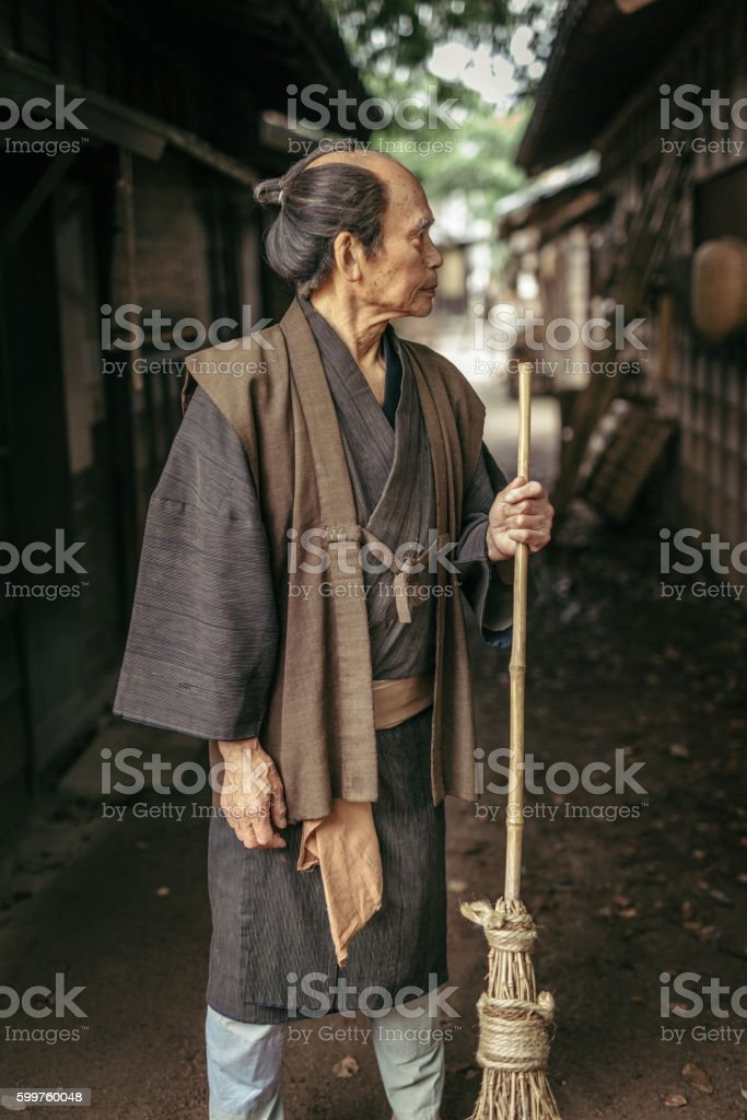 Japanese Man with straw broom stock photo