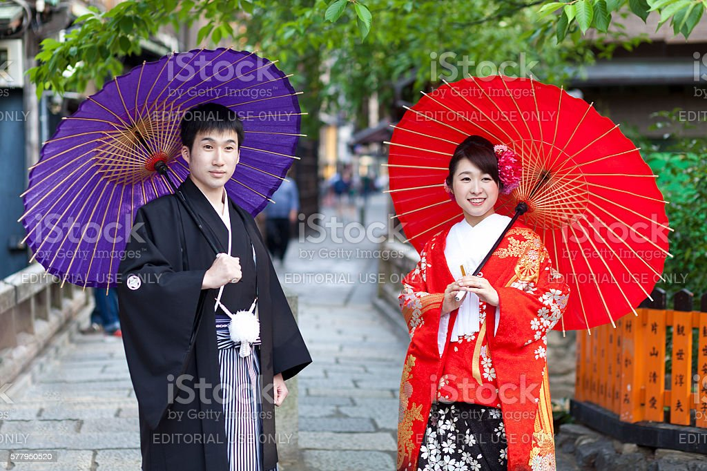 Japanese married couple in traditional cloths walking in the Gion stock photo
