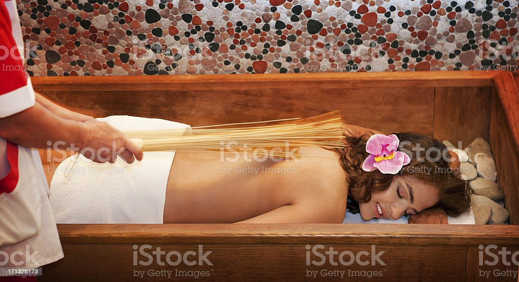 Japanese Massage with Bamboo Sticks. royalty-free stock photo