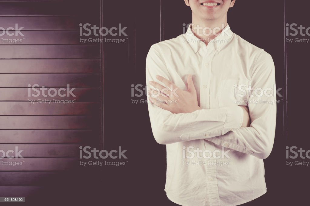 Japanese men are standing in front of the wood closet doors stock photo