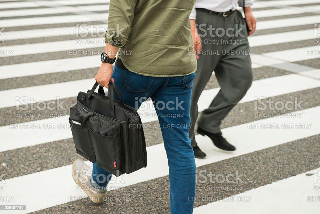 Japanese Men Walking Opposite Directions at Street Crosswalk Nagoya Japan stock photo