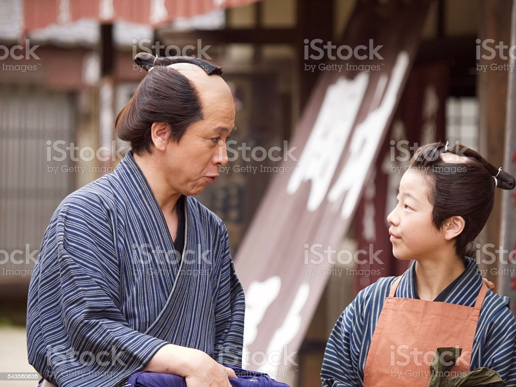 Japanese merchant and his assistant in Edo Period stock photo