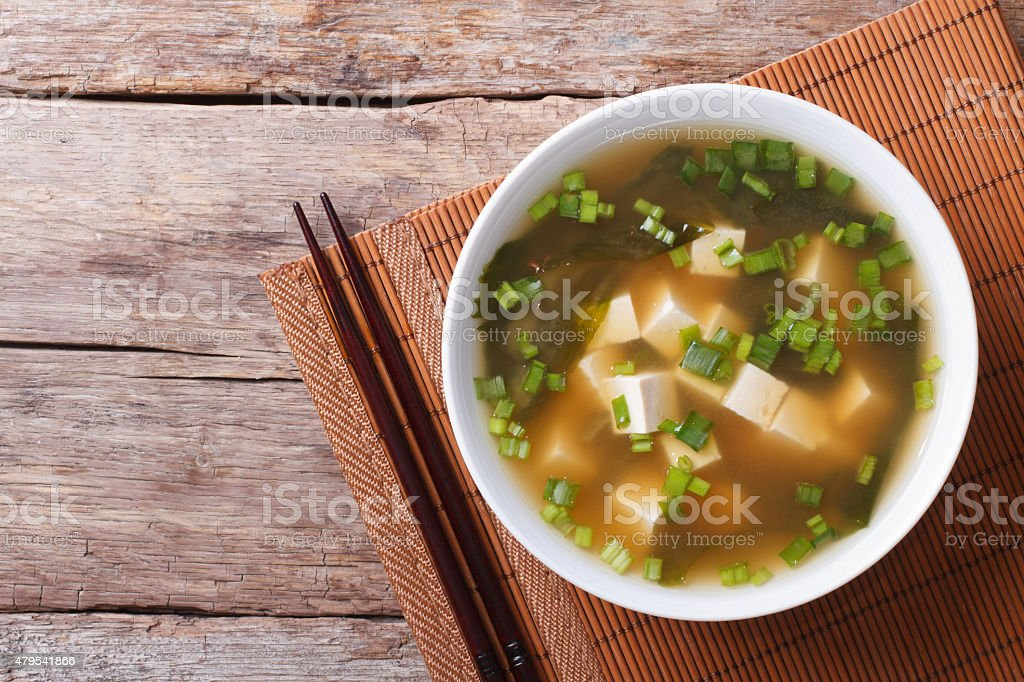 Japanese miso soup in a white bowl horizontal top view stock photo