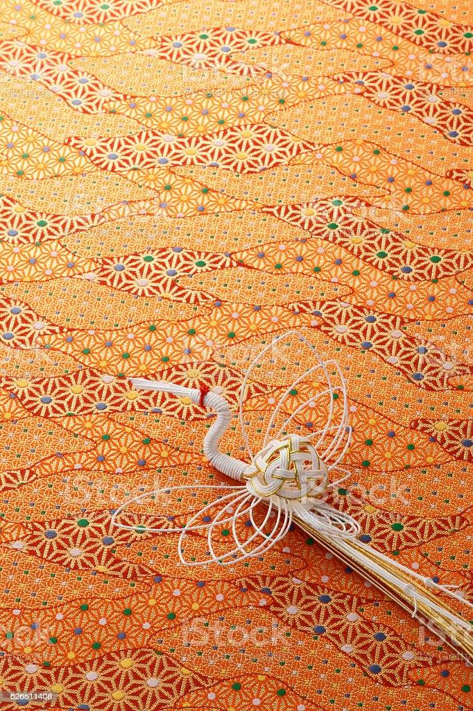 Japanese mizuhiki on patterned fabric stock photo