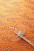 Japanese mizuhiki on patterned fabric