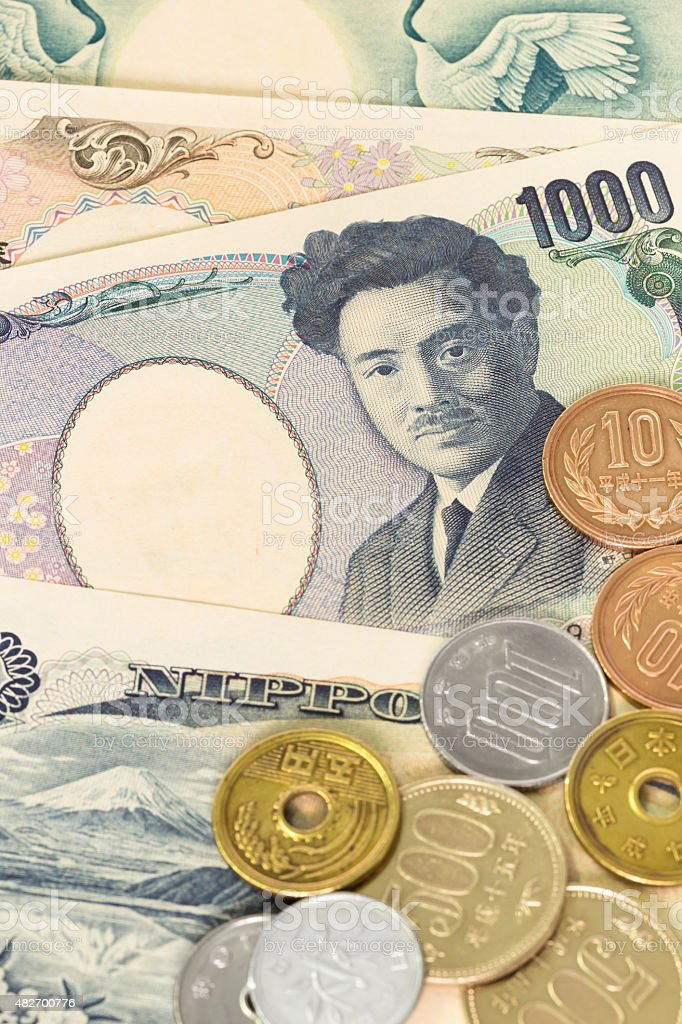 Japanese money yen banknote and coins close-up stock photo