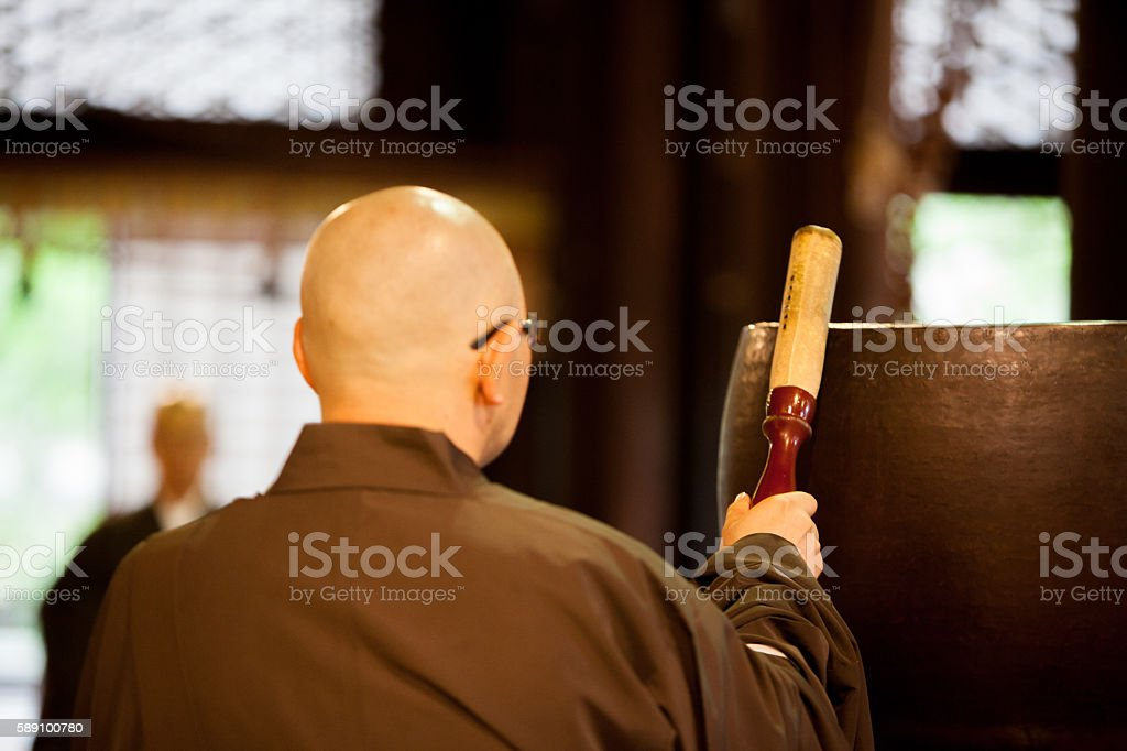 Japanese monks praying inside a Buddhist Temple stock photo