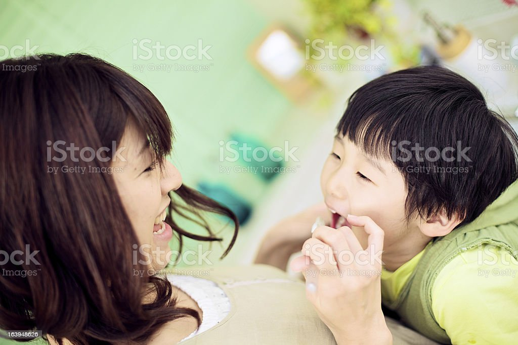 Japanese Mother and Son Brushing Teeth royalty-free stock photo