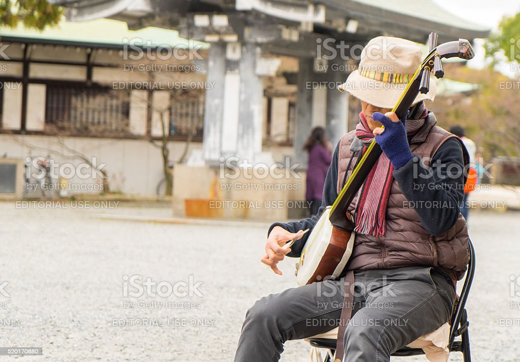 Japanese Musician in Public park stock photo