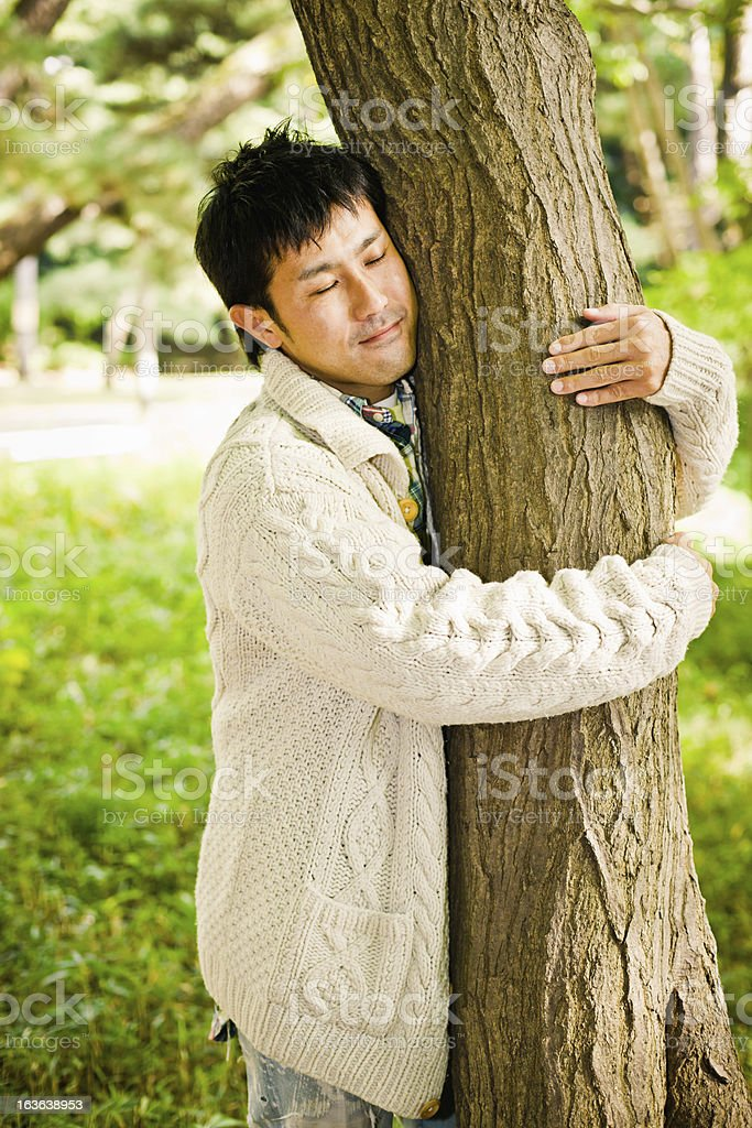 Japanese Nature Lover Young Man Taking Care about Environmental Conservation stock photo