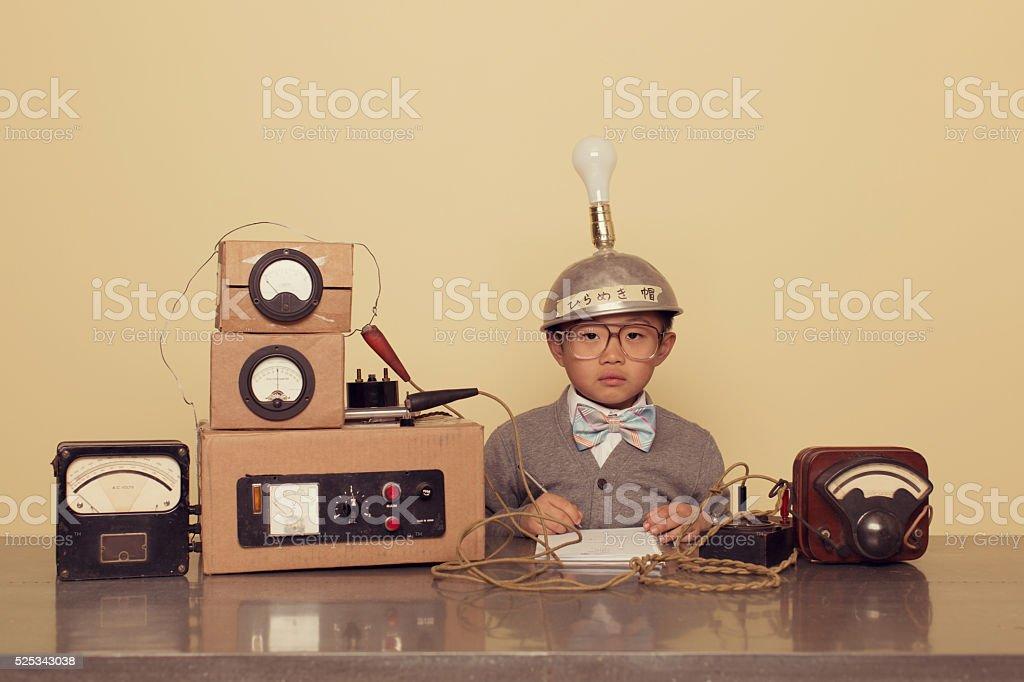 Japanese Nerd Boy Wearing Thinking Cap stock photo