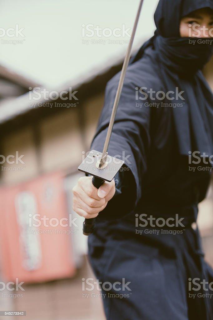 Japanese Ninja holding his sword stock photo