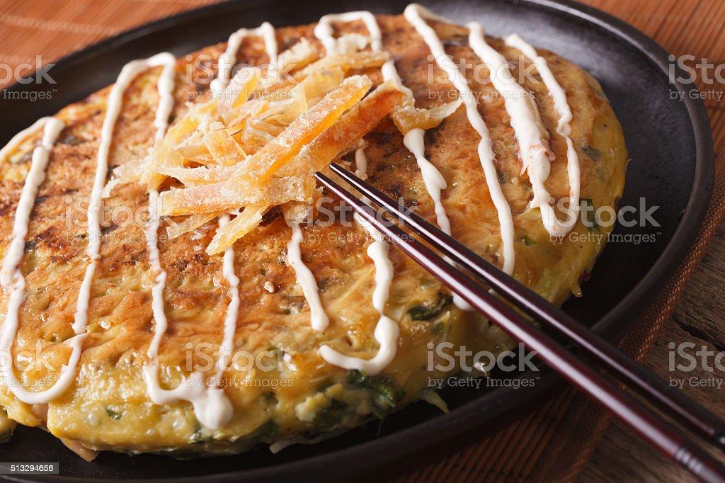 Japanese okonomiyaki pizza macro. horizontal stock photo