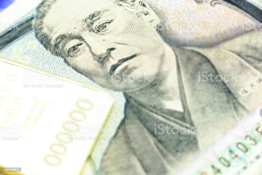 Japanese one thousand yen, a macro close-up with gold bullion. stock photo