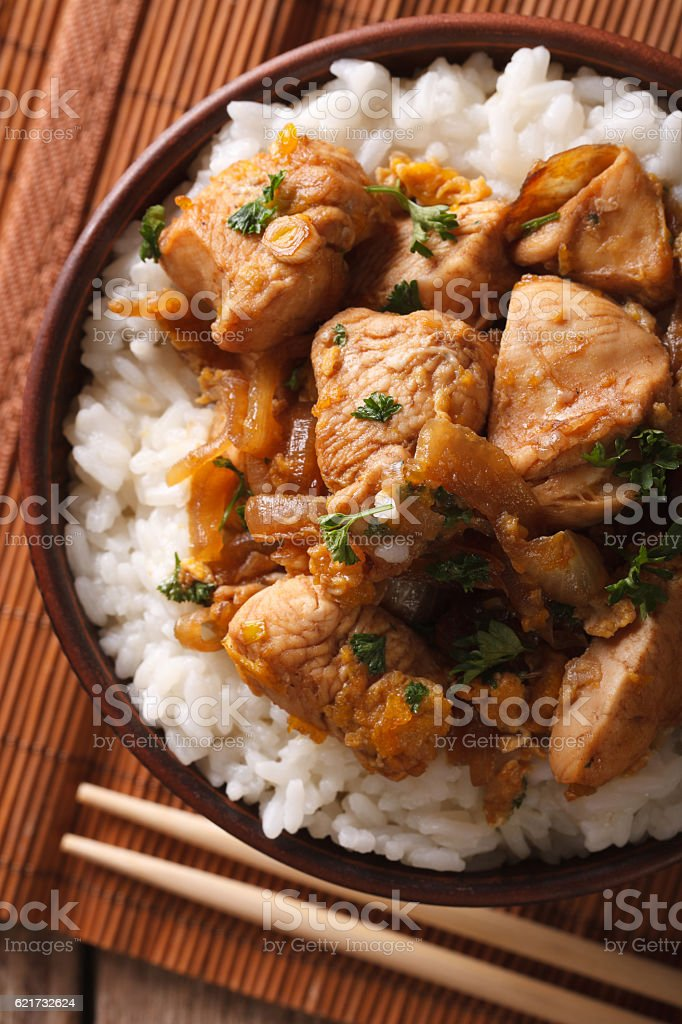 Japanese oyakodon and rice close-up in bowl. vertical top view stock photo