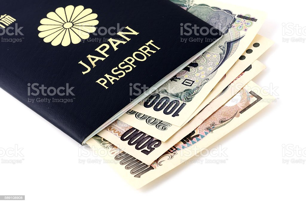 Japanese passport and currency isolated on white stock photo