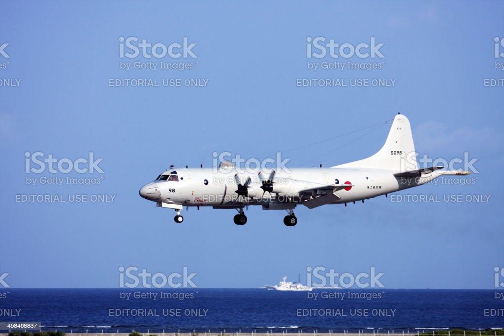 Japanese patrol airplane landing in Naha Airport stock photo