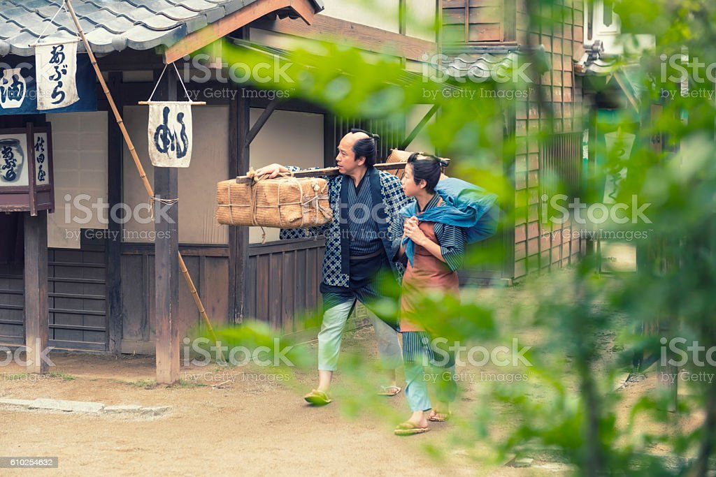 Japanese Peasant and His Son in old town, Kyoto stock photo