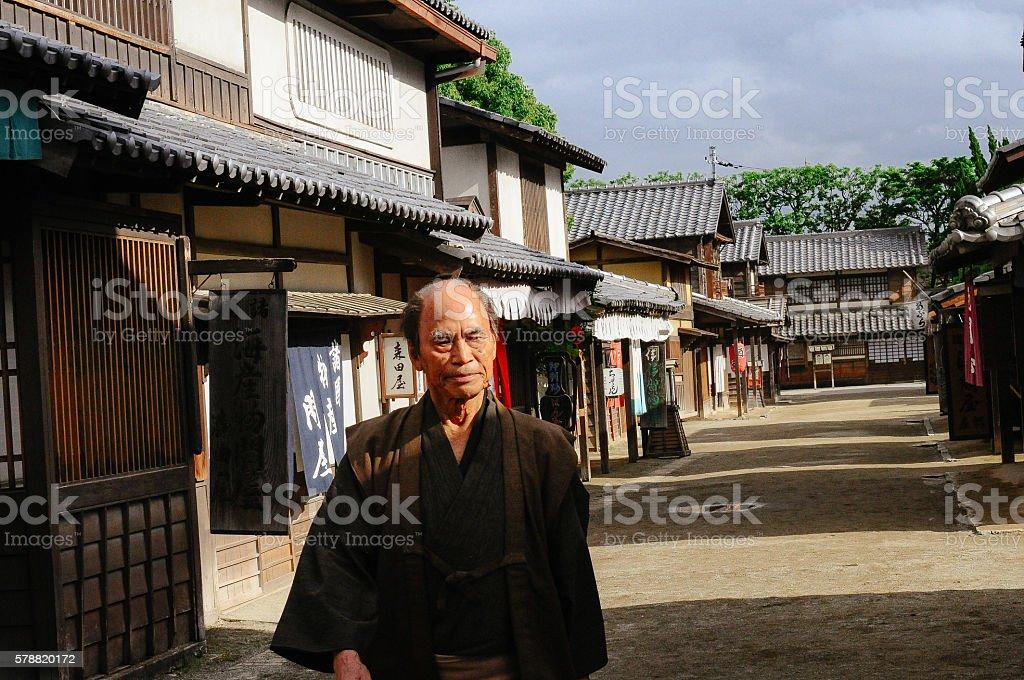 Japanese peasant walking on traditional village stock photo