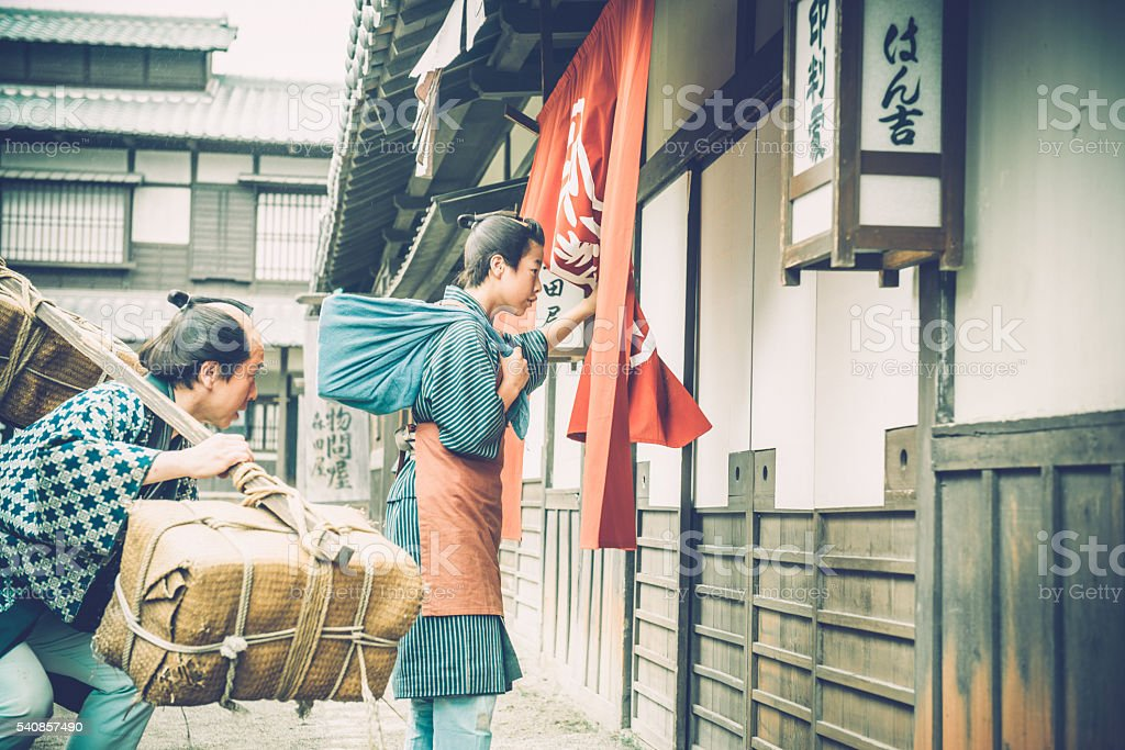 Japanese Peasant with Burden and His Son, Edo Period, Kyoto stock photo