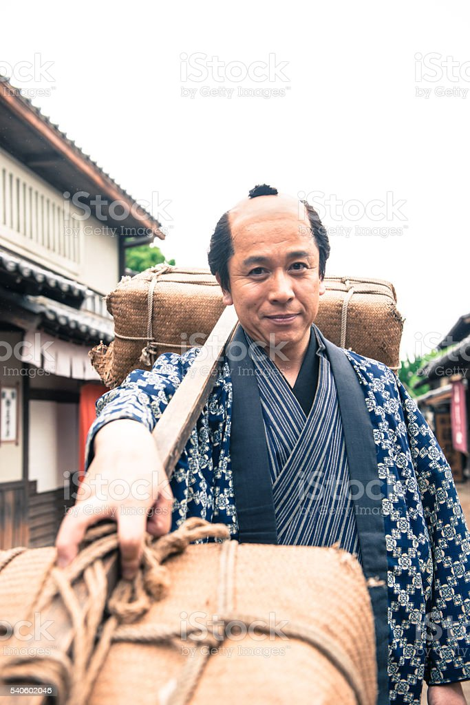 Japanese Peasant with Burden in Old Japanese Town, Edo Period stock photo
