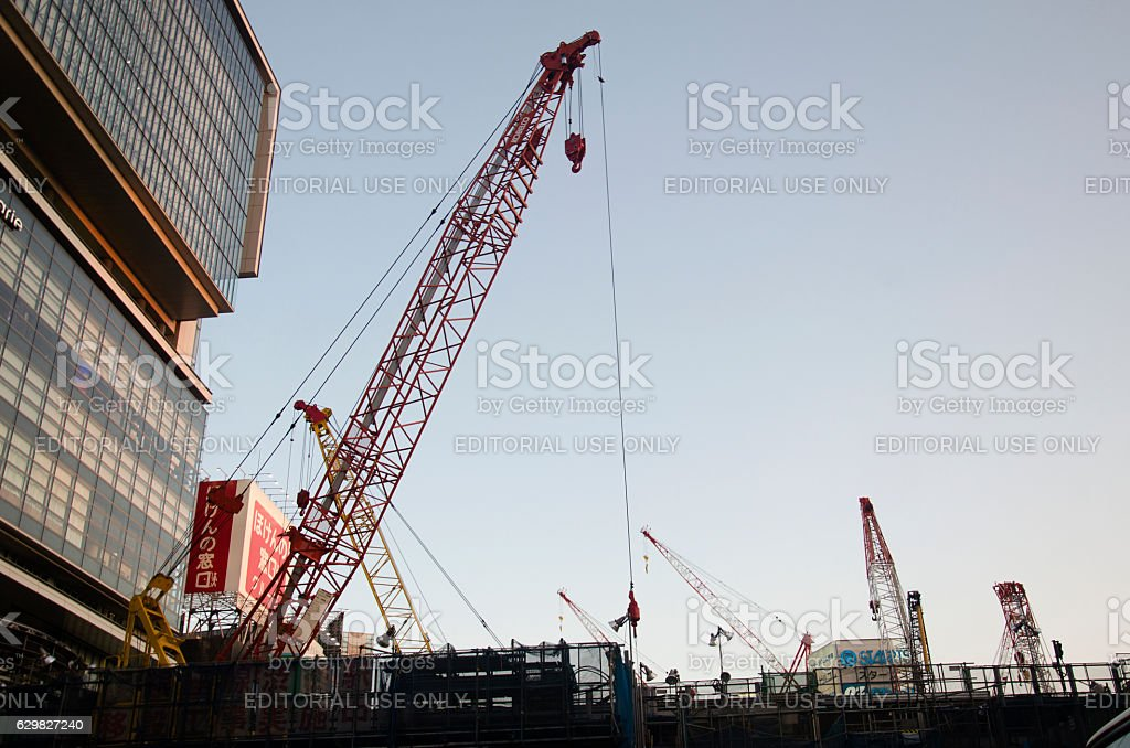 Japanese people and machinery working in construction site stock photo