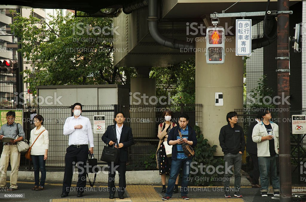Japanese people and traveler foreigner waiting traffic sign stock photo