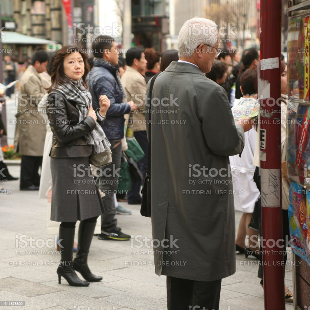 Japanese people are standing at a crosswalk stock photo