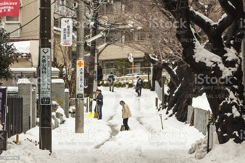 Japanese people removing snow with a shovel stock photo