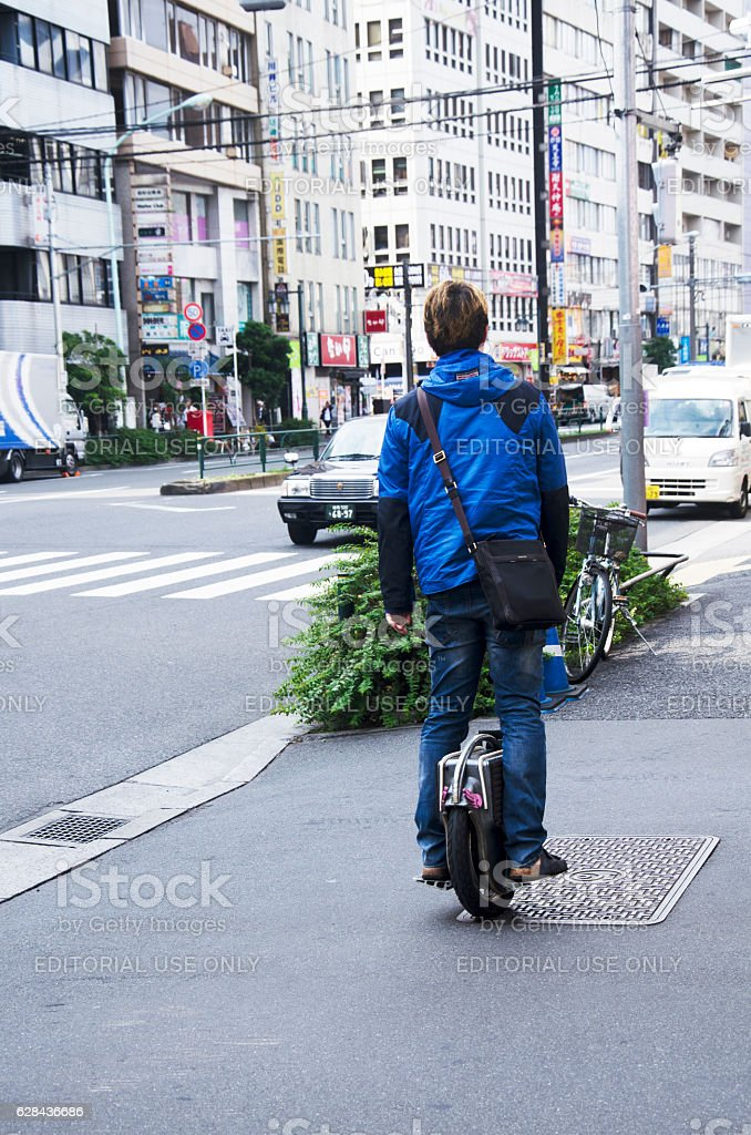 Japanese people standing and riding unicycle stock photo
