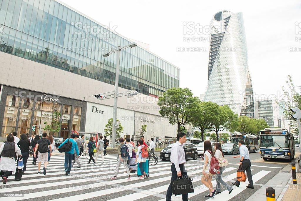 Japanese People Walking Acoss Crowded Crosswalk at Nagoya Street Intersection stock photo