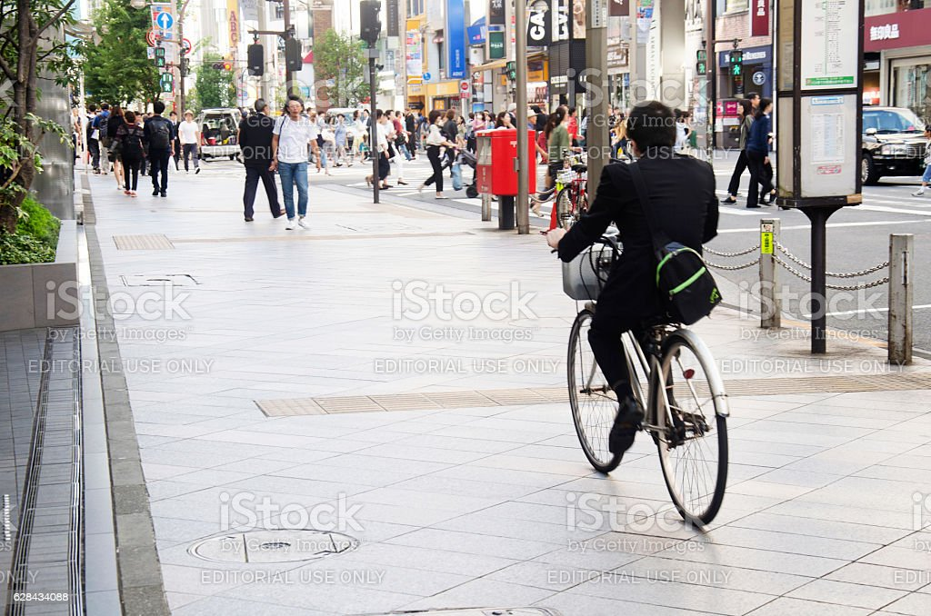 Japanese people walking crosswalk traffic road and biking stock photo