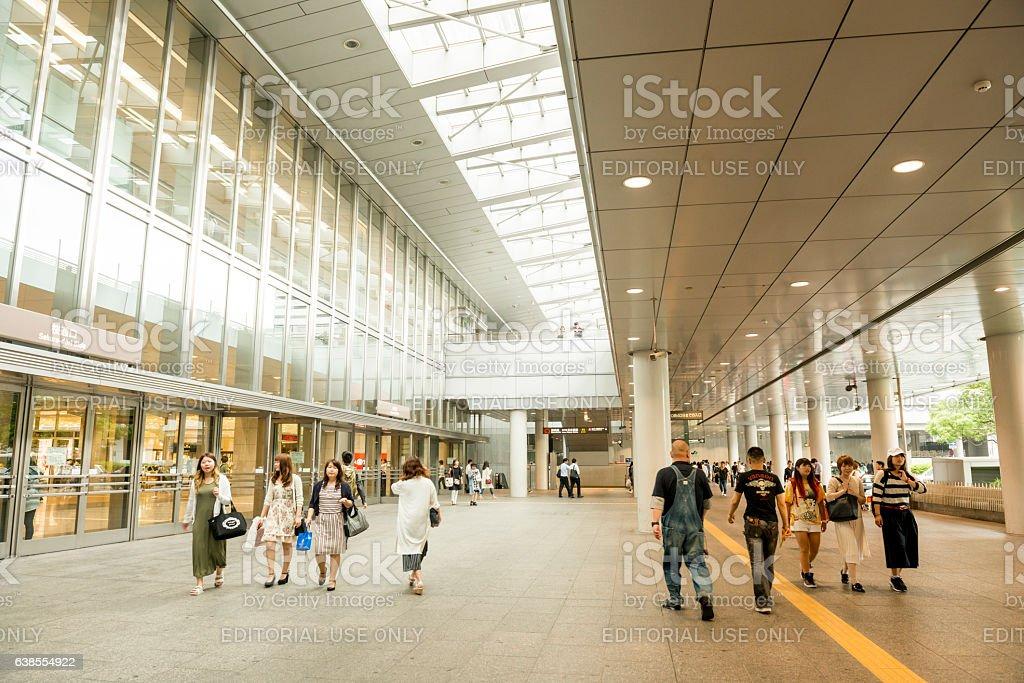 Japanese People Walking Outside Urban Nagoya Train Station Japan stock photo