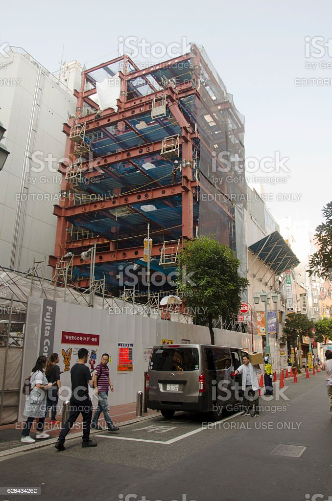 Japanese people working on construction site stock photo