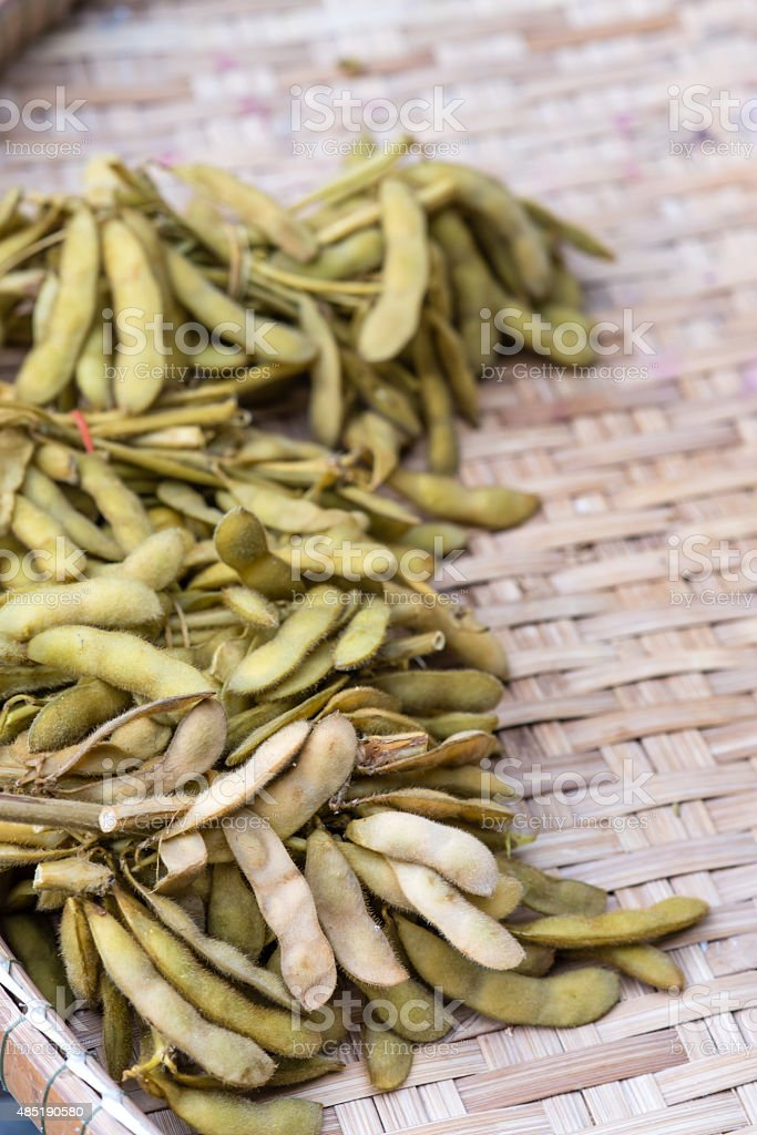 Japanese Pigeon Pea on Bamboo Weave Background stock photo