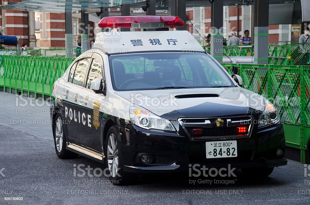 Japanese policemen people driving cop car on the road stock photo