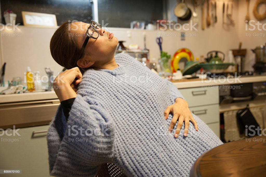Japanese pregnant mother feeling the beginnings of labor stock photo